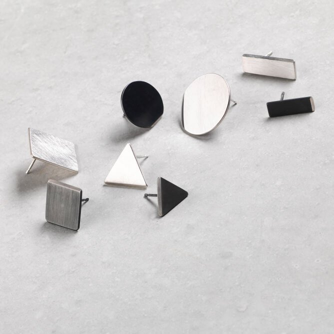 Sheng Zhang group of handmade triangle rounc square rectangle oxidised textured silver earrings jewellery